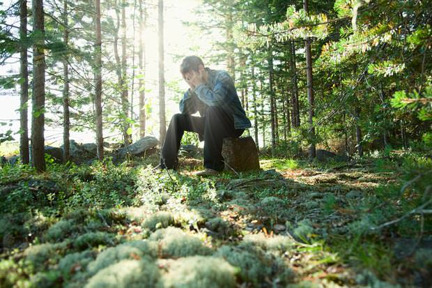 bigstock-Sad-Young-Man-Sits-In-Wood-On--6080994