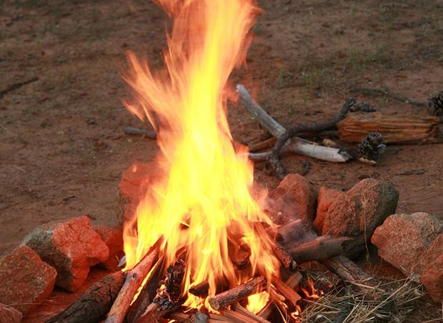 bigstock-a-camp-fire-in-a-fire-pit-at-a-25922735